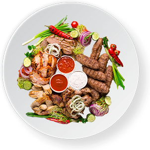 Variety of grilled meat with vegetables and dipping sauces