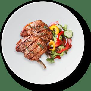 Pork meat grilled with fresh vegetable salad on side
