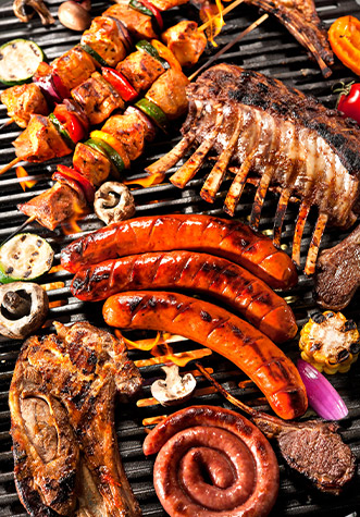 Delicious range of  grilled meat on a barbecue